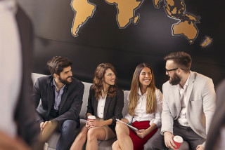 Business people chatting in front of world map
