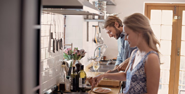 Couple cooking in kitchen together